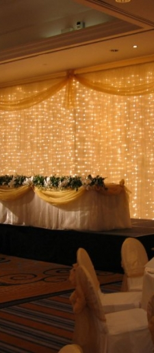 Cream backdrop with lights and top table decor
