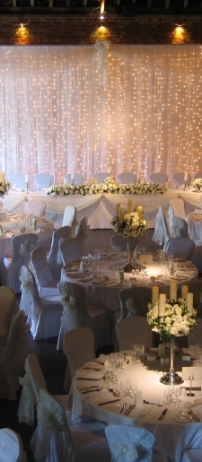 White backdrop with lights and pillar decor