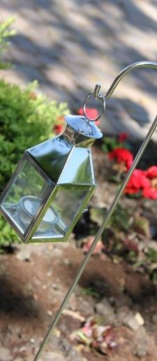 Small silver lanterns on stake