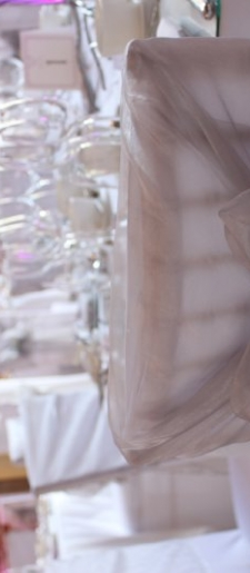 Organza-chair-decor-wrapped-over-the-top-of-a-chiavari-chair