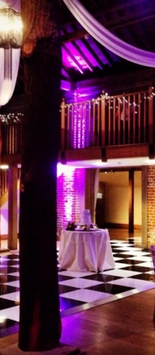 Black and white floor with magenta uplighting at Gaynes Park