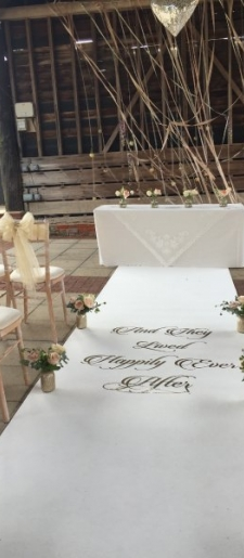 Outside-ceremony-with-ribbon-backdrop